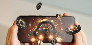 Creative,Background,,Online,Casino,,In,A,Man's,Hand,A,Smartphone